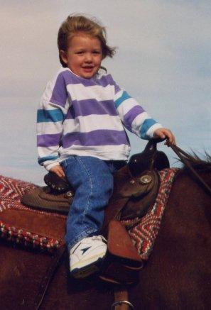 mk little girl in saddle
